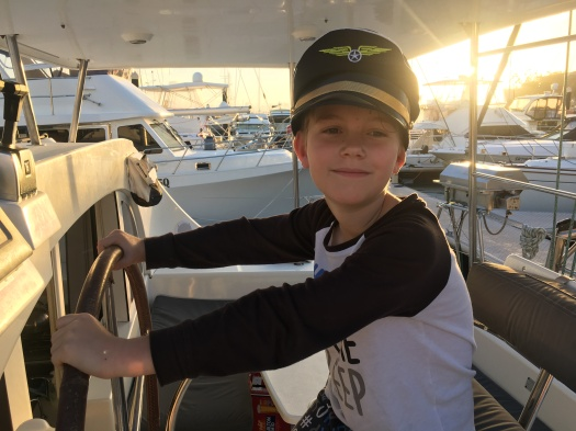 Young boy sailing the catamaran