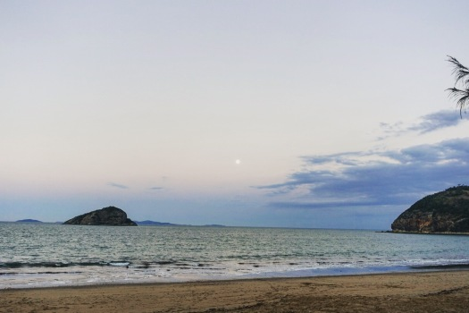 As the sun sets the moon rises over Great Keppel Island