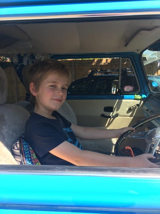 Child  in a blue kombi